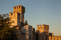 Sunset on castle at sirmione the crenelated towers of the glow in the last rays of the sun Royalty Free Stock Image
