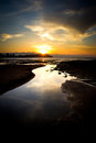 Sunset on a city beach gij�n asturias Stock Photos