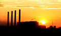 Sunset and cloud over cityscape and airport orange gas turbine electrical power plant Stock Photo