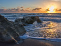 Sunset at coral cove park jupiter florida over rocky beach in Stock Photos