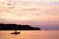 Sunset in costa rica a beautiful wit a fishboat Stock Photography