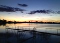 Sunset on the cotton farm by jetty a dam used to irrigate a located in wee waa australia Royalty Free Stock Photo