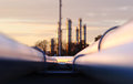 Sunset at crude oil refinery with pipeline network Royalty Free Stock Photo