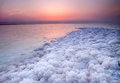 Sunset at dead sea jordan strong and big salt crystal located on coast of Royalty Free Stock Photos