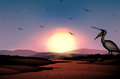 A sunset at the desert with a flock of birds illustration Royalty Free Stock Photos