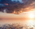 Sunset dramatic with clouds reflected in water Stock Photography