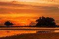 Sunset ebb tropical beach in time on background Royalty Free Stock Image