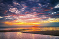 Sunset ebb tropical beach in time on background Royalty Free Stock Photos