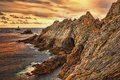 Sunset at the end of the world beuatiful on pointe du raz located on finistere coast in brittany north west france this is france Stock Photos