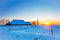 Sunset of farm in winter landscape Royalty Free Stock Image