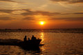 Sunset the fisherman went home at on the island of karimun central java indonesia Royalty Free Stock Images