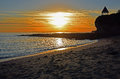 Sunset at Fishermans Cove Beach in Laguna Beach, California. Royalty Free Stock Photo
