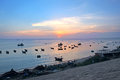 Sunset fishing boats in harbor mui ne vietnam Royalty Free Stock Photography