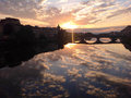 Sunset in florence with beautiful sky reflections in arno italy Royalty Free Stock Photography