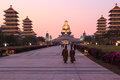 Sunset at fo guang shan buddist temple of kaohsiung taiwan with many tourists walking by december Royalty Free Stock Image
