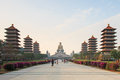 Sunset at Fo Guang Shan buddist temple of Kaohsiung, Taiwan with many tourists walking by. Royalty Free Stock Photo