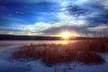 Sunset on a frozen lake everning Royalty Free Stock Photos