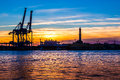 Sunset at Genoa`s port, silhouette of the Lanterna, Italy Royalty Free Stock Photo