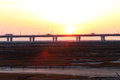 The sunset glow, the world's longest bridge have vehicles in traffic Royalty Free Stock Photo