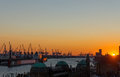 Sunset at the hamburg harbor with landungsbruecken Royalty Free Stock Photos