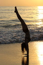 Sunset handstands a teenage girl does on the beach at manuel antonio beach costa rica Royalty Free Stock Photography