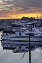 Sunset in the harbor harbour boats foreground Stock Images