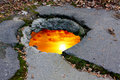 Sunset on hole in road Royalty Free Stock Photo