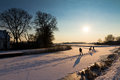 Sunset ice skating Royalty Free Stock Photo