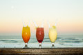 A sunset image showing mixed drinks lined up Royalty Free Stock Photo