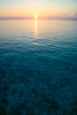 Sunset on the indian ocean in maldives embudu island Royalty Free Stock Photography