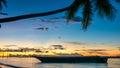 Sunset on Kri Island. Boats under Palmtrees. Raja Ampat, Indonesia, West Papua Royalty Free Stock Photo