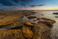 Sunset at la perouse sydney beautiful beach in Royalty Free Stock Photo