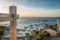 Sunset in Lacerda Elevator and All Saints Bay Baia de Todos os Santos in Salvador - Bahia, Brazil. Royalty Free Stock Photo