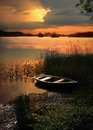 Sunset lake with rowing boat Royalty Free Stock Photo