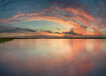 Sunset on lake in summer time Royalty Free Stock Photo