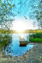 Sunset on lake with view of wooden bridge Royalty Free Stock Image