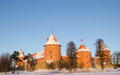 Sunset light trakai castle winter people tourists beautiful sunlight on in and recreate near it Royalty Free Stock Image