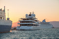 Sunset luxury large super or mega motor yacht in the evening on Royalty Free Stock Images