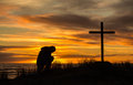 Sunset man of prayer beautiful as bows down to pray god before a cross Royalty Free Stock Photos