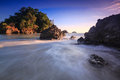 Sunset at manuel antonio national park costa rica beautiful sky and pacific ocean waves crashing on the rocky volcanic coastline Stock Photo