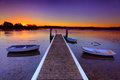 Sunset moorings and boat jetty in a little cove Australia Stock Images