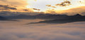 Sunset in mountain amazing over the clouds Stock Images