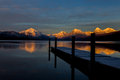 Sunset mountains reflection lake dock this image showing the on the mountain peaks with the on the and the in the foreground was Royalty Free Stock Photos