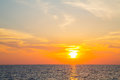 Sunset on the ocean with horizon for an atmospheric background. Royalty Free Stock Photo
