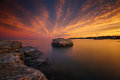 Sunset by the ocean with rock in the middle of the water image was taken at new haven connecticut beach during golden hours just Royalty Free Stock Images