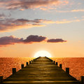 Sunset ocean scenery with wooden boardwalk to the endless horizon Royalty Free Stock Photo