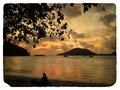 Sunset on the ocean, silhouettes. Old postcard Royalty Free Stock Photo