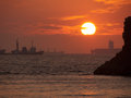 Sunset ocer south chinese sea over with huge vessel in the background Royalty Free Stock Photos