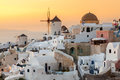 Sunset at oia santorini vibrant over houses and villas greece Royalty Free Stock Photography