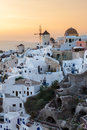 Sunset at oia santorini vibrant over houses and villas greece Royalty Free Stock Photos